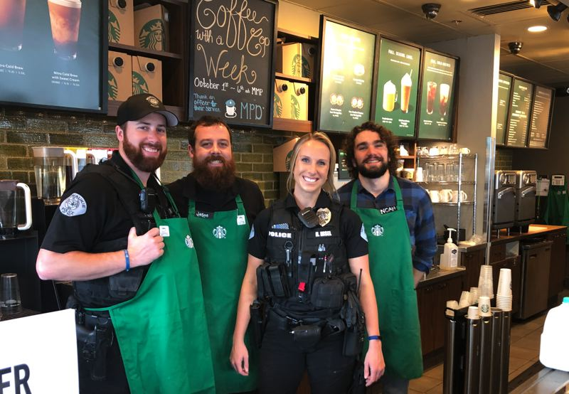 PMG PHOTO: ALVARO FONTAN - Milwaukie Police Officers David McVeigh and Heather Hisel join Starbucks employees Jason Poppert and Noah Bisceglia for a photo-op on Thursday.