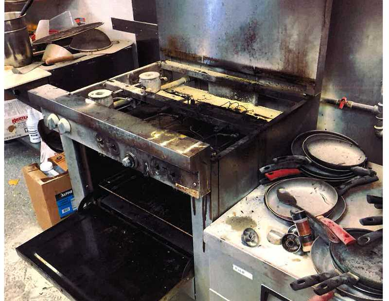 SUBMITTED PHOTO - The cooking stove at Madras Brewing was the only thing damaged when the stove caught fire Sept. 28. Restaurant staff and law enforcement got the fire put out, but smoke still remained when the fire department arrived.