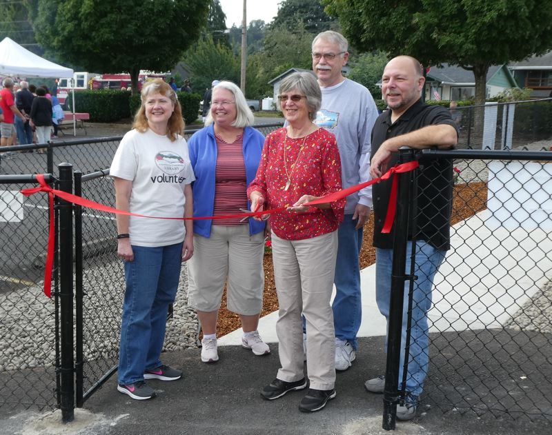 COURTESY PHOTO - Columbia City Community Library Director, Cathy Lundberg, Friends of Library President Wendy Wells, project coordinator Kit Gardes, Columbia City Mayor Casey Wheeler and St. Helens School District Superintendent Scot Stockwell pose for a photo at a ceremonial ribbon-cutting for the Columbia City Community Library on Saturday, Sept. 14. Volunteers with the library announced new hours starting this month after a series of facilities upgrades were completed earlier this year.