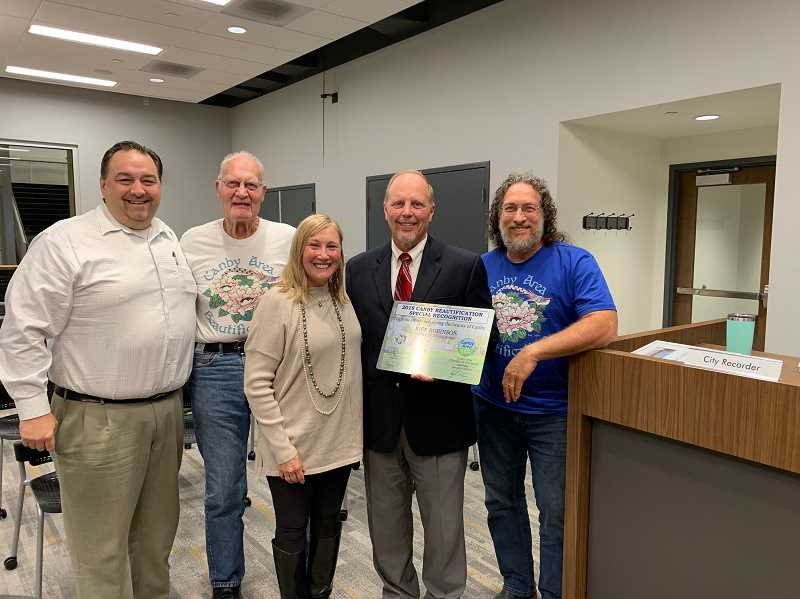 PMG PHOTO: CAROL ROSEN - Rick Robinson receives the 2019 Canby Beautification Special Recognition Award at the Oct. 2 city council meeting. Pictured from left are: Mayor Brian Hodson, Vern Hulit, Cathy Rae Smith, Robinson and Haunt Rama.