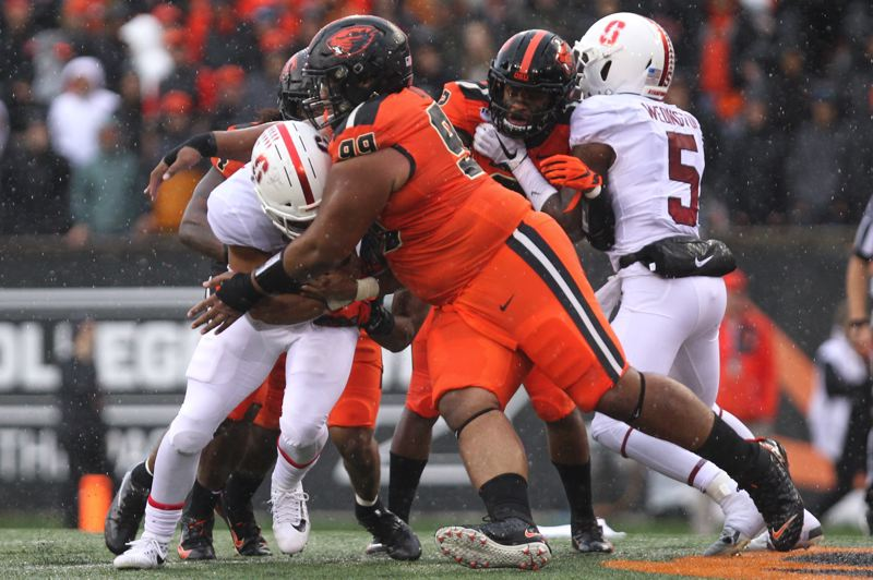 PMG PHOTO: JAIME VALDEZ - Elu Aydon makes a tackle for Oregon State against Stanford.