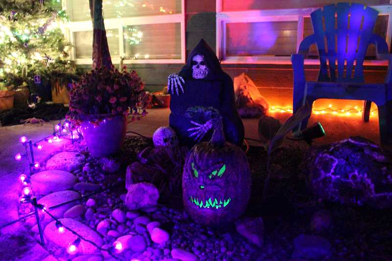 COURTESY PHOTO - Nighttime is the right time for cruising by the Scappoose Halloween House, which has numerous displays illuminated via an array of eerie lights.
