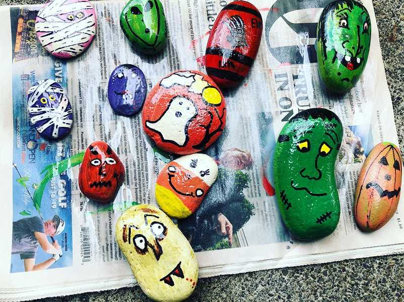 COURTESY PHOTO - Kristen Younts and family painted rocks in classic Halloween imagery and hid them in parts of south Columbia County. The rocks have a message for finders to snap a photo of themselves with the discovered rock so that it could be posted on the Scappoose Halloween House's social media pages.