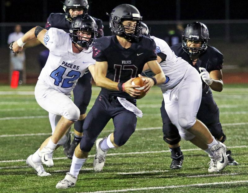 PMG PHOTO: DAN BROOD - Tualatin quarterback Blake Jackson and the No. 6 Timberwolves are back in action tonight when they host Canby at 7 p.m. at Tualatin High School.