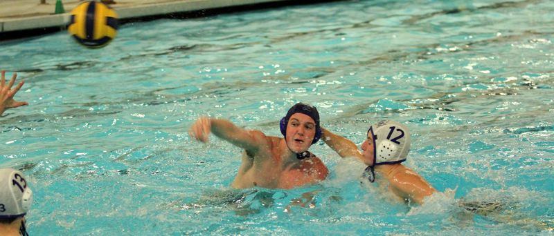 PMG PHOTO: MILES VANCE - Lakeridge's Thomas Gooding takes a shot during his team's 9-8 loss to Newberg at Lake Oswego School District Pool on Wednesday, Oct. 2.