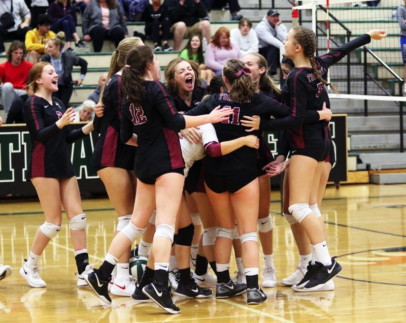 PMG PHOTO: DAN BROOD - Members of the Tualatin High School volleyball team celebrate following the final point of their 25-17, 25-19, 25-16 over rival Tigard in Thursday's TRL match.