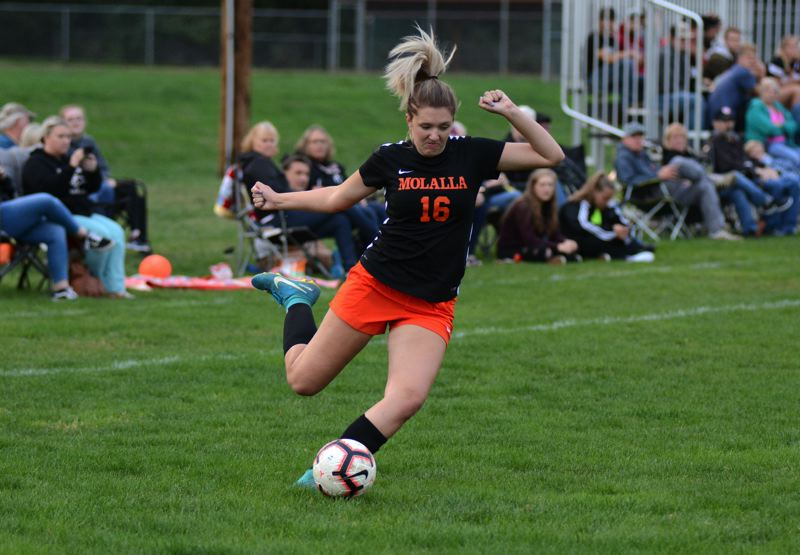 PMG PHOTO: DEREK WILEY - Molalla junior Kaityn Curry scored one of the Indians eight goals Tuesday against Corbett.