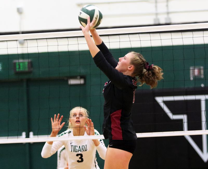 PMG PHOTO: DAN BROOD - Tualatin High School senior Jackie Phillips sets the ball during the Timberwolves' 3-0 league win over Tigard on Thursday.