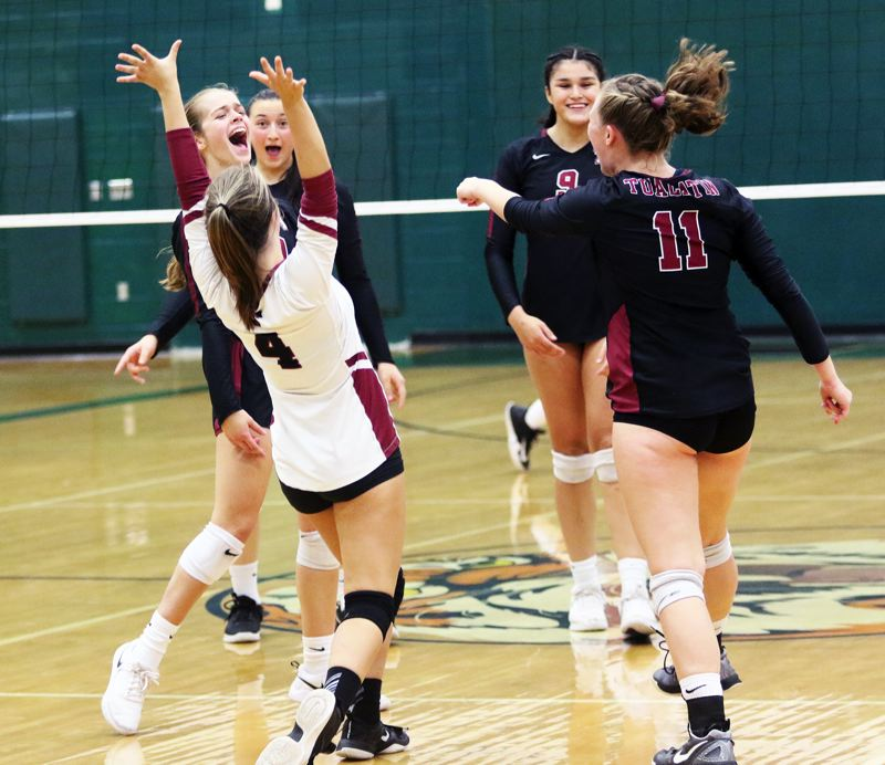 PMG PHOTO: DAN BROOD - Tualatin players, including Bella Valdes (4), Olivia Ashley (9) and Jackie Phillips celebrate during the Tigers' victory over Tualatin on Thursday.