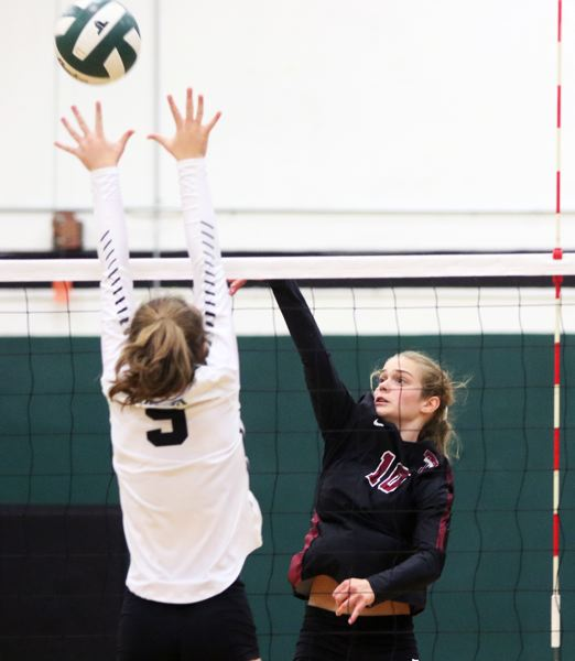 PMG PHOTO: DAN BROOD - Tualatin High School sophomore Sophie Biehler hits the ball over the net during the Wolves' win over Tigard on Thursday.