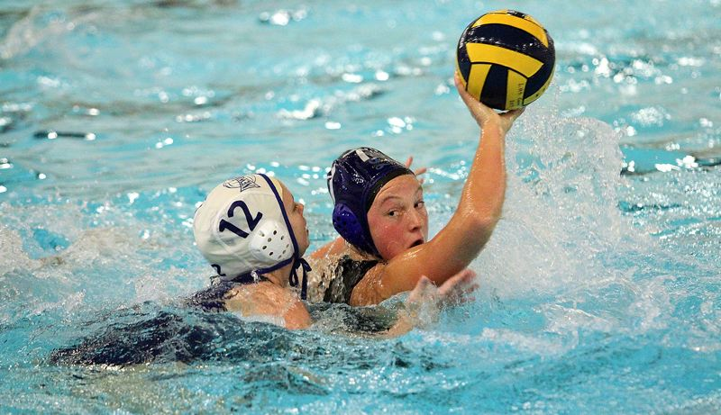 PMG PHOTO: MILES VANCE - Lakeridge junior Molly Glad looks to pass during her team's 15-6 loss to Newberg at Lake Oswego School District Pool on Wednesday, Oct. 2.