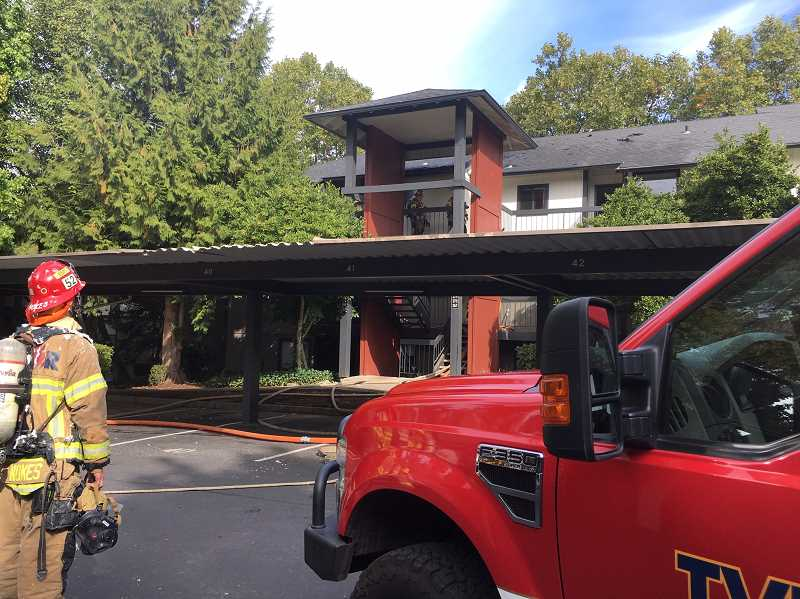 COURTESY PHOTO: TUALATIN VALLEY FIRE & RESCUE - Firefighters put out a fire at the Bridge Creek Apartments in Wilsonville last week.