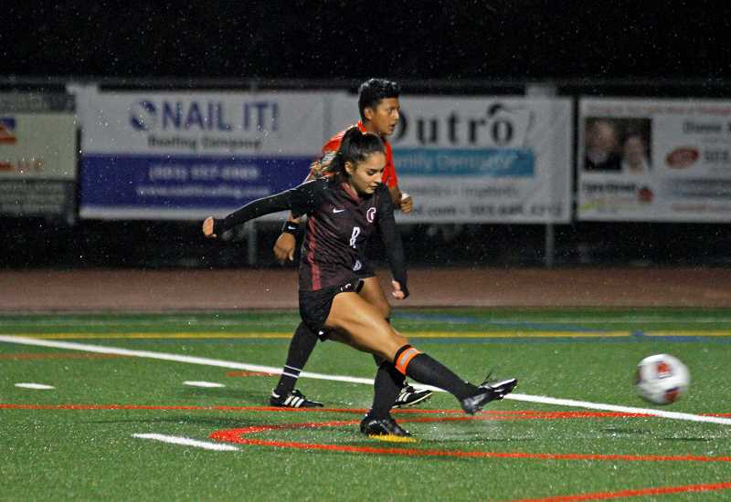 PMG PHOTO: WADE EVANSON - Glencoe's Alexis Magdaleno takes a penalty kick in the first half of the Tide's game against Canby Thursday, Oct. 3, at Hare Field.