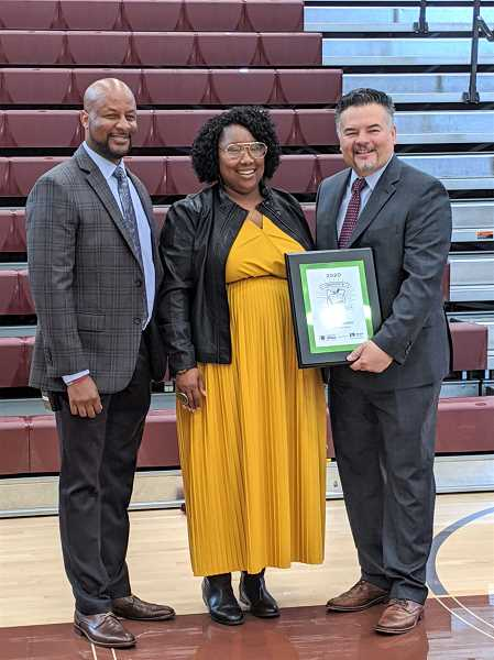 PMG PHOTO: COURTNEY VAUGHN - Mercedes Muñoz (center) receives the 2020 Oregon Teacher of the Year award Friday, Oct. 4. Franklin High School Principal Chris Frazier (left) and Portland Public Schools Superintendent Guadalupe Guerrero (right) both gave speeches during an award ceremony for Muñoz.