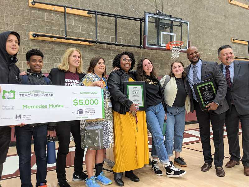PMG PHOTO: COURTNEY VAUGHN - Franklin High School teacher Mercedes Muñoz is joined by Portland Public Schools board members, students and faculty, as well as the Portland Association of Teachers union president Friday after receiving the 2020 Oregon Teacher of the Year award.