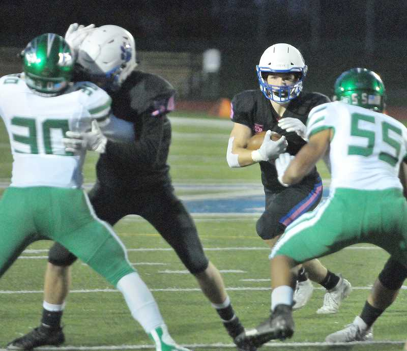 GRAPHIC PHOTO: GARY ALLEN - Newberg ran the ball at the Raiders early and often in Friday's win over Reynolds at Loran Douglas Field.