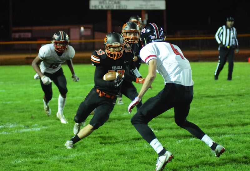 PMG PHOTO: DEREK WILEY - Molalla senior Afanasy Kutsev returns an interception in the fourth quarter of the Indians 13-7 victory over Tillamook Friday night.