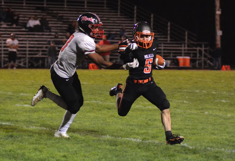 PMG PHOTO: DEREK WILEY - Max Tate carries the ball in the third quarter Friday against Tillamook.