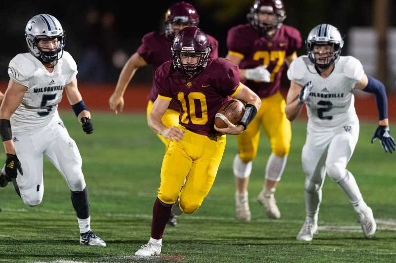 PMG PHOTO: CHRISTOPHER OERTELL - Forest Grove's Christopher Doyle runs through the Wilsonville defense during the Vikings' game against the Wildcats Friday, Oct. 4, at Forest Grove High School.