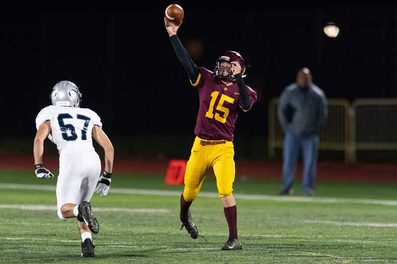 PMG PHOTO: CHRISTOPHER OERTELL - Forest Grove quarterback Jarod Miller hurls a pass during the Vikings' game against the Wildcats Friday, Oct. 4, at Forest Grove High School.