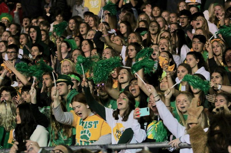 J. BRIAN MONIHAN - West Linn High School students rock the stands during the school's annual homecoming game.