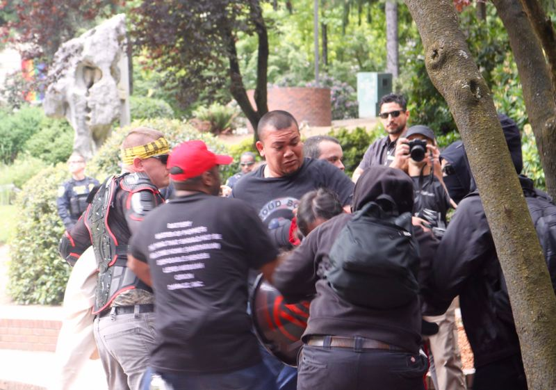 PMG PHOTO: ZANE SPARLING - Tusitala 'Tiny' Toese, center, brawls near Portland City Hall during a political protest involving Patriot Prayer and antifa in 2018.