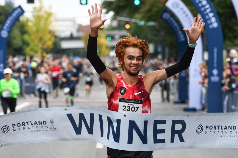 PMG PHOTO: CHRISTOPHER OERTELL - Kallin Khan captures the 48th Portland Marathon on Sunday morning on Southwest Naito Parkway.