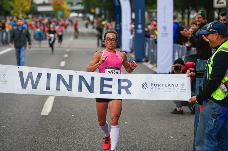 PMG PHOTO: CHRISTOPHER OERTELL - Jamie Gibbs, a Nike employee, finishes first among women in Sunday's Portland Marathon.