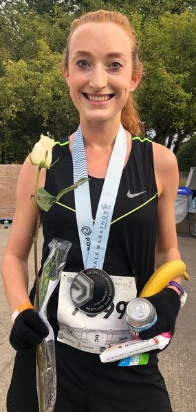 PMG PHOTO: STEVE BRANDON - Sarah Reiter of Portland is all smiles after her women's half-marathon win Sunday.
