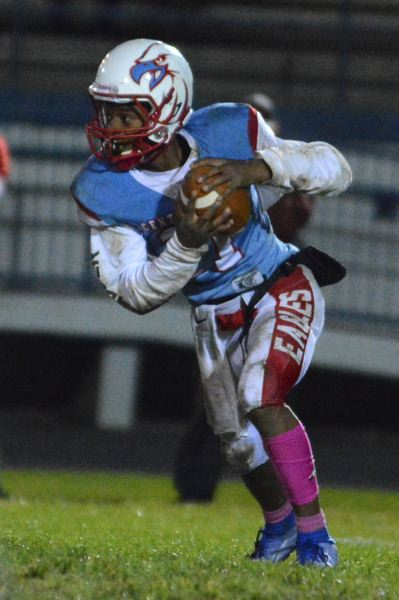PMG PHOTO: DAVID BALL - Centennial rookie QB Langston Williams-Lomax rolls out of the pocket during the Eagles 33-13 loss to McMinnville on Friday.