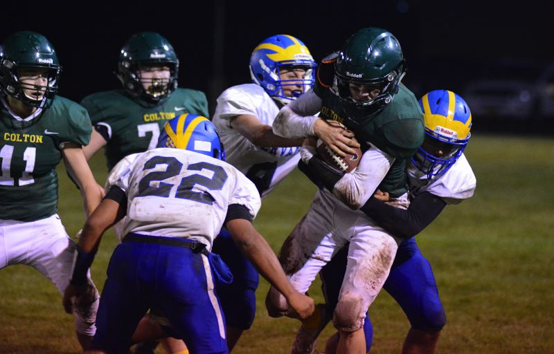 PMG PHOTO: DEREK WILEY - Colton senior Seth Ethington runs into Gervais territory late in the first half Friday.