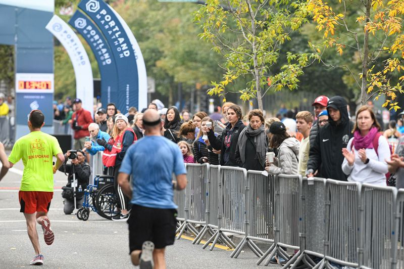 PMG PHOTO: CHRISTOPHER OERTELL - Onlookers line the chute near the finish line of the Portland Marathon on Sunday morning in downtown.