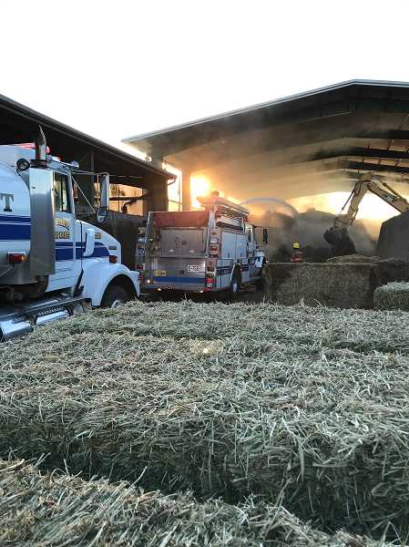 ST. PAUL FIRE DISTRICT - Barn full of hay ignited spontaneously near St. Paul.