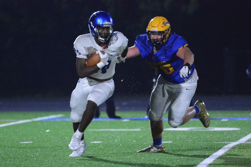 PMG PHOTO: DAVID BALL - Barlow lineman Jesse Wilson chases after Grant running back Jaden Moses.