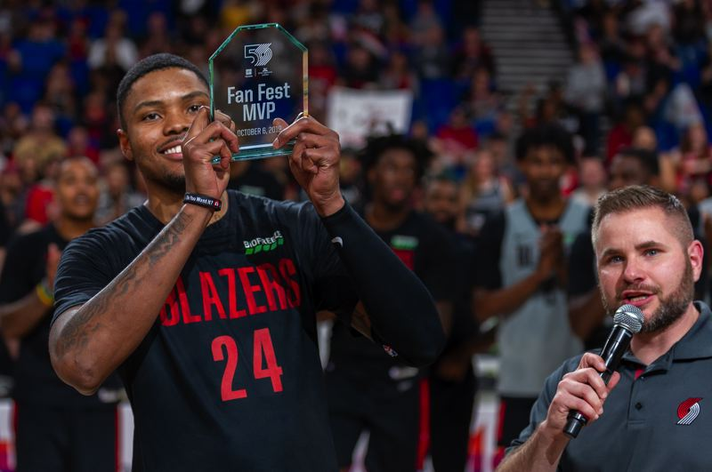 COURTESY PHOTO: DIEGO G. DIAZ - New Blazer Kent Bazemore is honored as MVP of Sunda'ys Fan Fest at Memorial Coliseum, with team radio play-by-play broadcaster Travis Demers making the presentation.