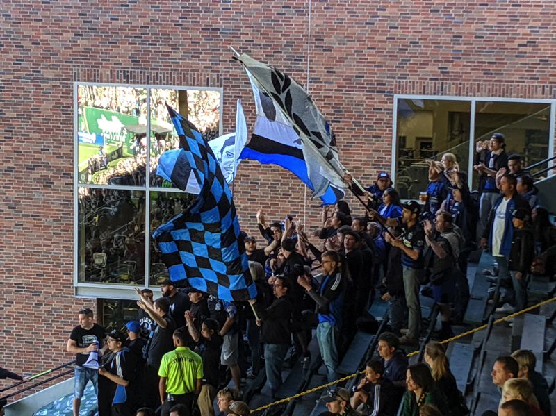 PMG PHOTO: JOSEPH GALLIVAN  - San Jose Earthquakes' ultras (boisterous away fans) at Providence Park on Sunday. It was the end of their season.