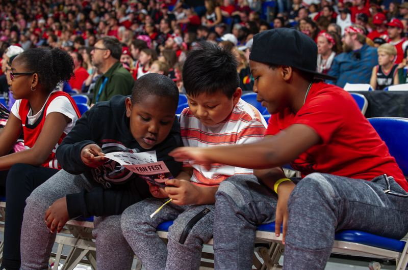 COURTESY PHOTO: DIEGO G. DIAZ - Some young fans look at the program for Sunday's Trail Blazers Fan Fest at Memorial Coliseum.