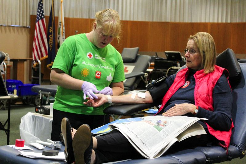 PMG PHOTO: CLARA HOWELL  - Meghan Mann, a Red Cross employee, works with Helen Leek, right, who is donating blood during the Red Cross Blood Drive Oct. 4.