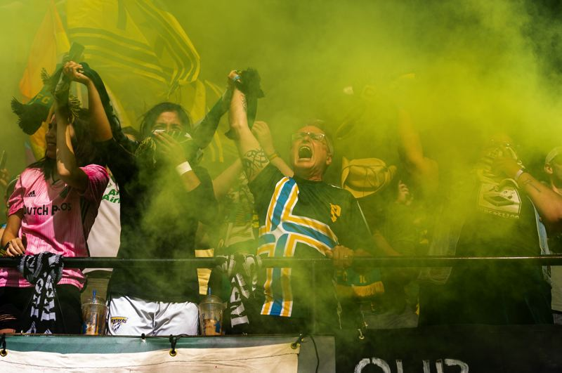 PMG PHOTO: DIEGO G. DIAZ - Portland Timbers fans celebrate Dairon Asprilla's goal in the 3-1 victory Sunday against San Jose.