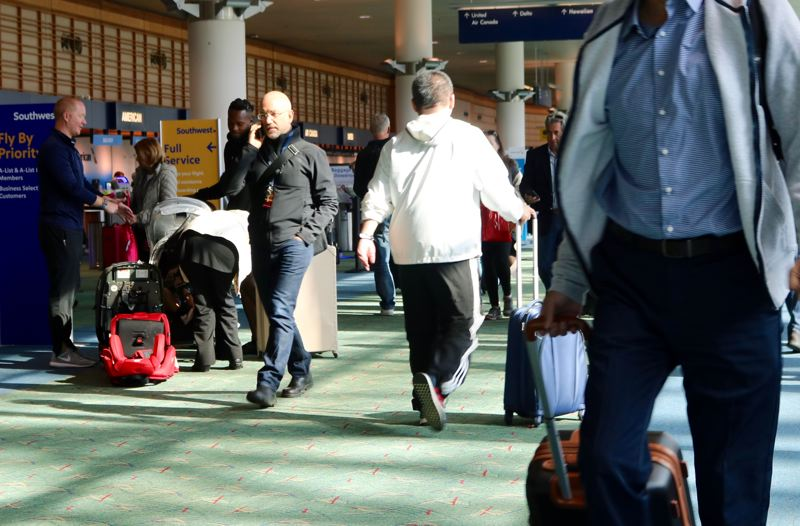 PMG PHOTO: ZANE SPARLING - About 5 million travelers pass through the gates of Portland International Airport each year. If you try to fly in late 2020 without a Real ID or passport, your trip through airport security may be delayed by 45 minutes or more.