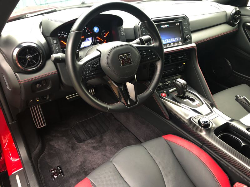 PMG PHOTO: JEFF ZURSCHMEIDE - Inside, the 2020 Nissan GT-R is a pure sports car experience, with a thick steering wheel and a dash that offers a wealth of information for the driver.