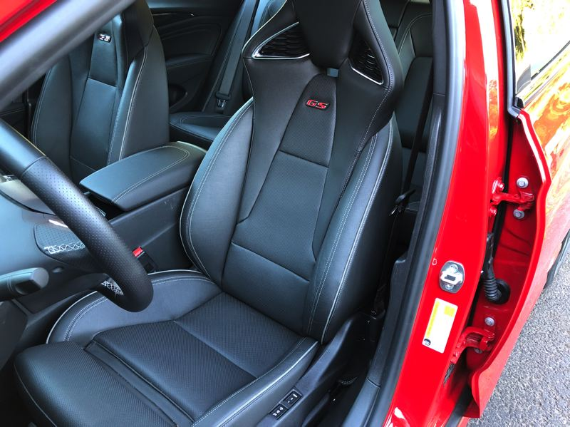 PMG PHOTO: JEFF ZURSCHMEIDE - The Regal continues its serious performance trim with well-bolstered sport seats trimmed in perforated leather. Both front seats are heated, as is the steering wheel.