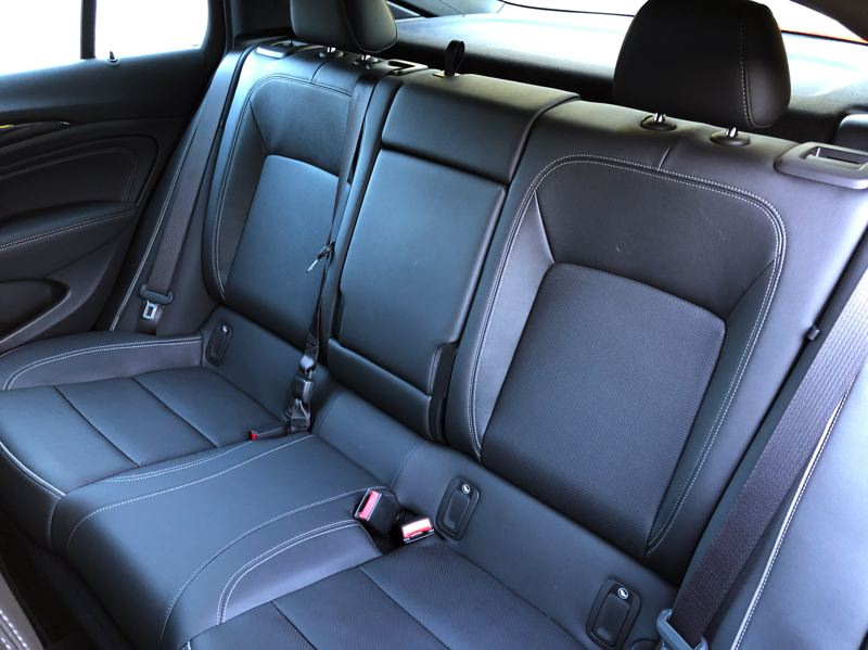 PMG PHOTO JEFF ZURSCHMEIDE - The rear seats are roomy and include a fold-down center console.