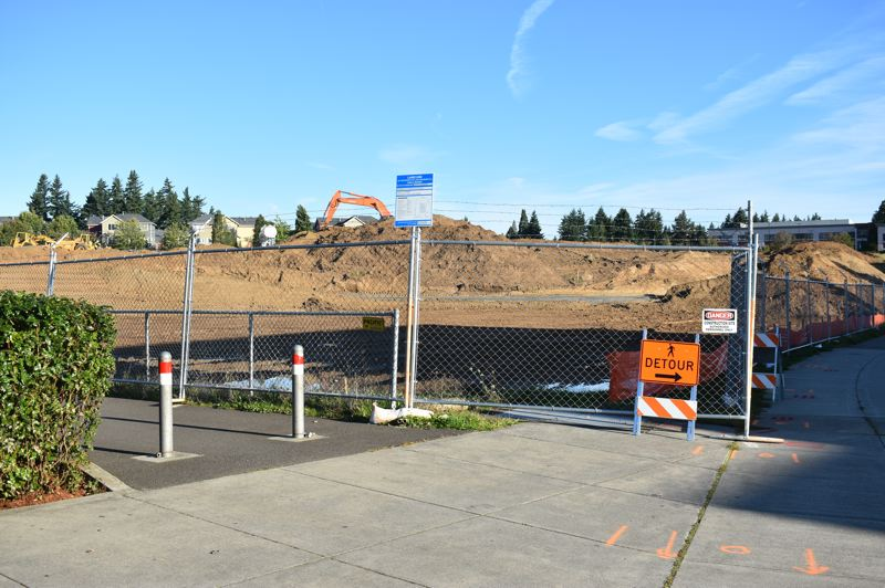 PMG PHOTO: TERESA CARSON - There is a lot of dirt being moved for the 318-unit Alta development going up next to the MAX station.