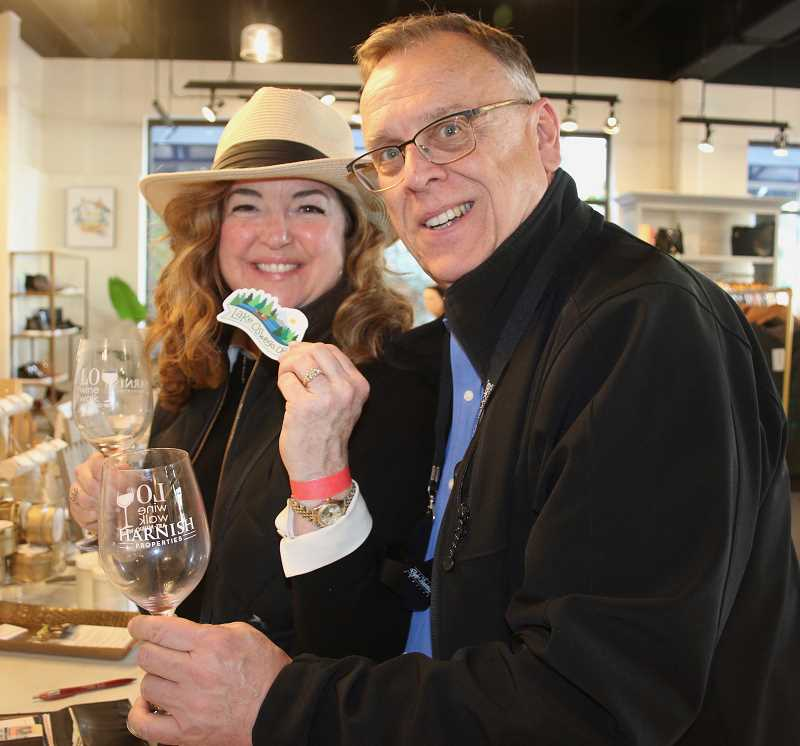 Because supporting Lake Oswego's businesses by shopping local is the reason for the LO Wine Walk, Nancy Niland and Andrew Edwards do their part by making a purchase at Mapel Boutique at Lake View Village.