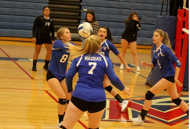 STEELE HAUGEN - Taylor Olson makes a dig for the Buffalos during Madras' 3-1 victory over the Gladstone Gladiators at home. That was the first win of the season for the Lady Buffalos.
