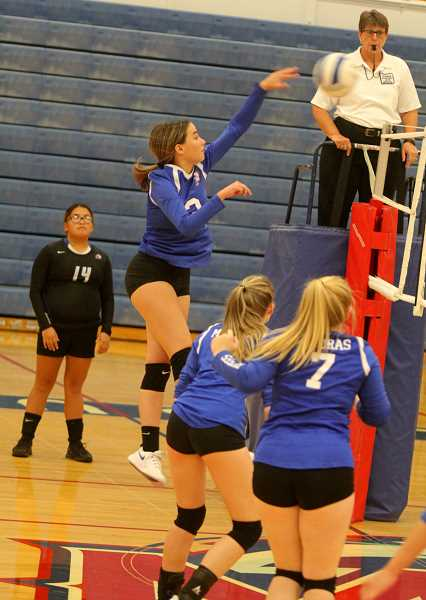 STEELE HAUGEN - Tegan Lantz spikes the ball during the Lady Buffs' 3-1 win over Gladstone Oct. 1.