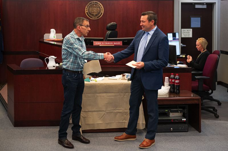 PMG PHOTO: CHRIS OERTELL - Frank Damato shakes hands with Judge D. Charles Bailey during a graduation day ceremony for the Veterans Treatment Court at Washington County Courthouse in Hillsboro, Ore., on Thursday, Oct. 3, 2019.