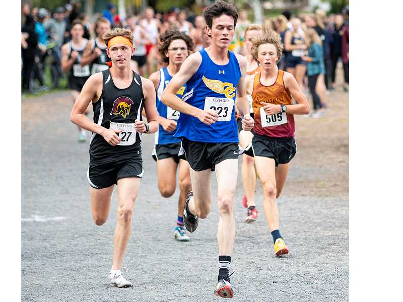 LON AUSTIN/CENTRAL OREGONIAN - Cade Catterson leads a pack of runners midway through the race on Friday. Alex Vail, who finished ahead of Catterson is right behind.