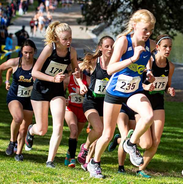 LON AUSTIN/CENTRAL OREGONIAN - Savannah Jessee, 235, races up a hill in front of a pack of runners at the Oxford Classics Invitational, which was held on Friday at Drake Park in Bend.